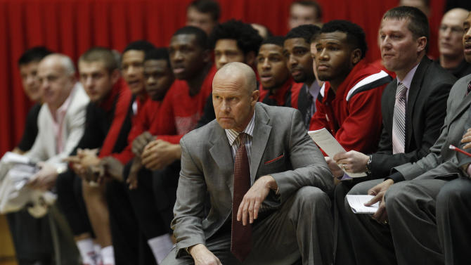 Cincinnati interim head coach Larry Davis (center) watches his team against Virginia Commonwealth in the first half of an NCAA college basketball game, Saturday, Dec. 20, 2014, in Cincinnati. (AP Photo/Frank Victores)