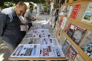 A Libyan looks at papers at a news stall the day after the country went to the polls in the eastern city of Benghazi on July 8, 2012. Libyans on Saturday went to the polls to elect a General National Congress, a 200-member legislature made up of both party and individual members, which is tasked of steering the country for a transition period