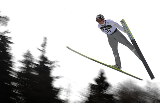 Haavard Klementsen of Norway soars trough the air during the NH Individual Gundersen Ski Jumping round of the FIS Nordic Combined World Cup event in Liberec on February 25, 2012.   AFP PHOTO / MICHAL