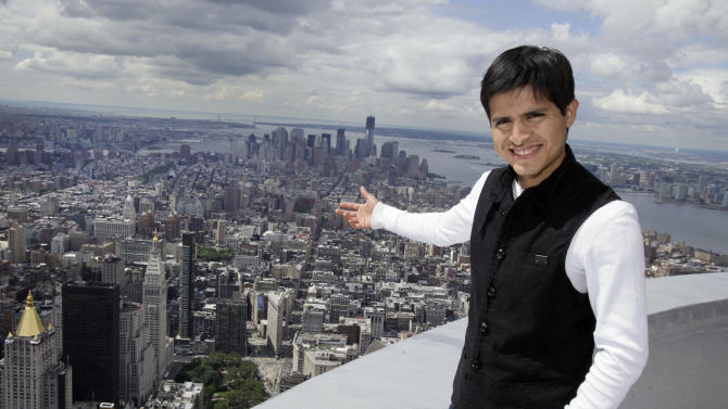 Mario Gutierrez, from Mexico, jockey for Kentucky Derby and Preakness winner  I'll Have Another, poses on the 103rd floor of New York's Empire State Building, Tuesday, June 5, 2012. I'll Have Another could become horse racing's 12th Triple Crown winner and first in 34 years on Saturday at the Belmont Stakes. (AP Photo/Richard Drew)