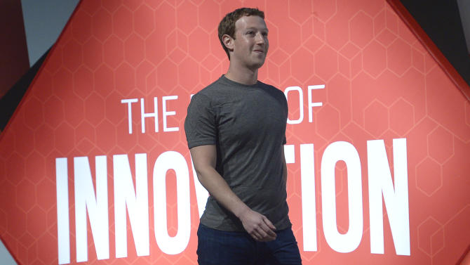 Facebook CEO Mark Zuckerberg arrives for a press conference at the Mobile World Congress, the world's largest mobile phone trade show in Barcelona, Spain, Monday, March 2, 2015. (AP Photo/Manu Fernandez)