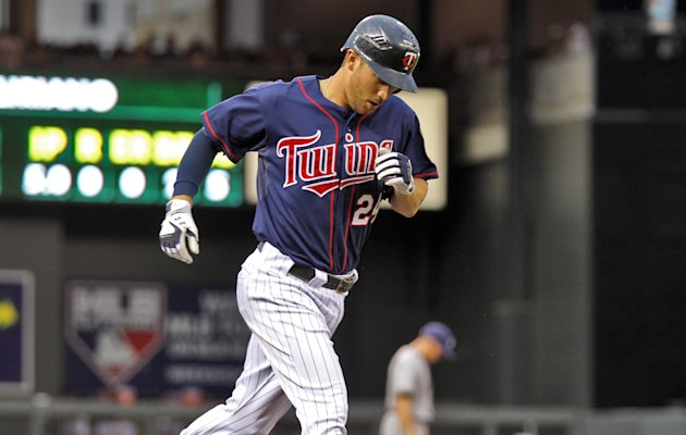 Minnesota Twins' Trevor Plouffe rounds the bases after hitting a home run in the fifth inning against the Milwaukee Brewers in Minneapolis, Friday, June 15, 2012. (AP Photo/The Star Tribune, Marlin Levison) ST. PAUL PIONEER PRESS OUT; MINNEAPOLIS-AREA TV NOT TV OUT; MAGAZINES OUT