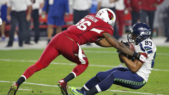 Arizona Cardinals strong safety Deone Bucannon (36) hits Seattle Seahawks wide receiver Doug Baldwin (89) during the first half of an NFL football game, Sunday, Dec. 21, 2014, in Glendale, Ariz. (AP Photo/Ross D. Franklin)