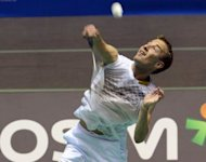 Peter Gade of Denmark hits a return against Hu Yun of Hong Kong during their men's singles first round match at the Japan Open badminton championships in Tokyo. Hu won 21-11, 22-20