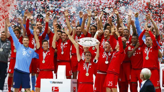 Bayern Munich's Lahm lifts up the trophy after their final German first division Bundesliga soccer match of the season against FSV Mainz 05 in Munich