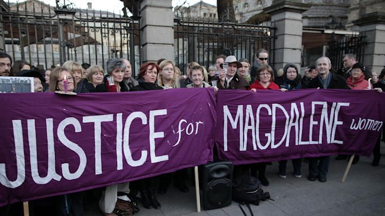 Relatives of victims of the Magdalene Laundries hold a candle lit vigil in solidarity with Justice for Magdalene Survivors and their families outside Leinster House, Dublin,Ireland, Tuesday, Feb. 19, 2013. The women expect to witness an apology by the Irish Prime Minister Enda  Kenny on behalf of the people of Ireland for ignoring them and their treatment at the 10 laundries in the Republic between 1922 and 1996. The women will also hear details of how the State intends to assist them financially and in other ways as restitution. (AP Photo/Peter Morrison)