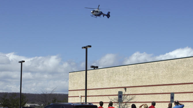 A medical helicopter approaches the parking lot outside the New River Valley Mall in Christiansburg, Va. on Friday, April 12, 2013. Officials say two women have been shot at the community college section of the mall and a suspect is in custody. (AP Photo/The Roanoke Times, Daniel Lin)
