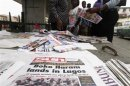 Newspapers are displayed at a stand along a road in Obalende district in Lagos