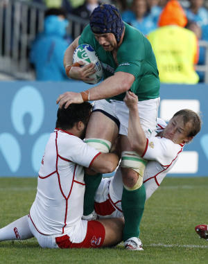 Russia's Valeriy Tsnobiladze, left, and Alexander Yanyushkin tackle Ireland's Sean O'Brien during their Rugby World Cup game in Rotorua, New Zealand, Sunday, Sept. 25, 2011. (AP Photo/Dita Alangkara)