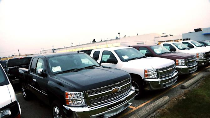 Chevrolet Silverado pickup trucks are seen on a dealer's lot in Troy, Mich., Monday, Dec. 17, 2012. General Motors is offering generous deals to clear a growing inventory of Chevy and GMC pickup trucks. Itís matching or beating deals offered by Ford and Chrysler. That, plus low interest rates, sweet lease deals and abundant financing, is good news for truck buyers. (AP Photo/Carlos Osorio)