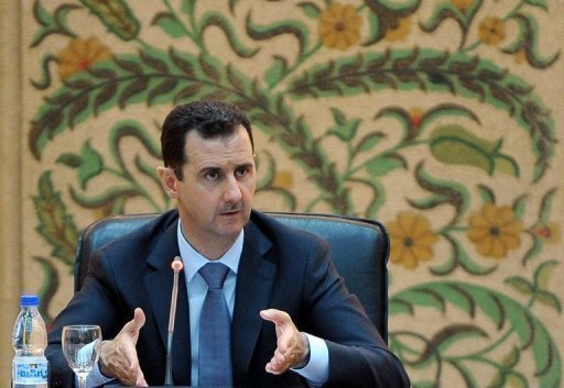 Syrian President Bashar al-Assad addresses his new cabinet during a swear-in ceremony in Damascus on June 23. Russia says the fate of Assad should be decided through a national dialogue, rejecting any solution imposed from abroad to end the violence in the country