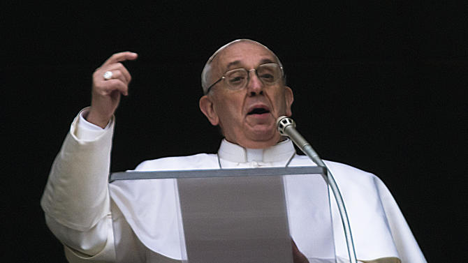 FILE - This is a Sunday, March 17, 2013 file photo of  Pope Francis gestures as he delivers his Angelus prayer from the window of his studio overlooking St. Peter's Square, at the Vatican. The election of a Jesuit pope devoted to the poor and stressing a message of mercy rather than condemnation has brought a glimmer of hope to American nuns who have been the subject of a Vatican crackdown accusing them of having focused too much on social justice at the expense of other church issues such as abortion, according to interviews with several groups.   (AP Photo/Domenico Stinellis, File)