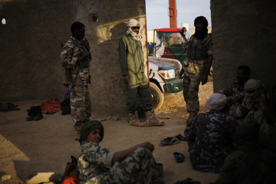 Tuareg soldiers in the Malian army man a checkpoint at the entrance of Gao, northern Mali, Friday Feb. 8, 2013. Earlier in the day, a suicide bomber on a motorcycle killed himself attempting to blow up an army checkpoint. It was the first time a suicide bomber operated in Mali. (AP Photo/Jerome Delay)