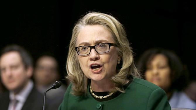 then-Secretary of State Hillary Rodham Clinton testifying on Capitol Hill