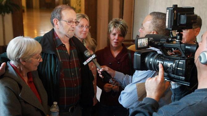 Jack Kern, second from left, addresses the media with his wife, Ellen, left, and daughter Barbara, after the jury recommended death for Richard Beasley in the courtroom of Summit County Common Pleas Court Judge Lynne Callahan, Wednesday, March 20, 2013, in Akron, Ohio. Kern's son, Tim, was one of the victims. Beasley, a self-styled street preacher, was convicted of killing three down-and-out men lured by bogus Craigslist job offers. (AP Photo/Akron Beacon Journal, Michael Chritton, Pool)