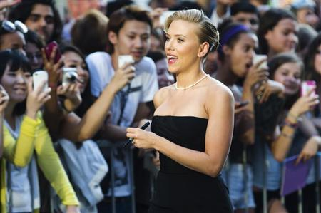 "Cast member Johansson arrives for a screening of the film ""Don Jon"" at the 38th Toronto International Film Festival"