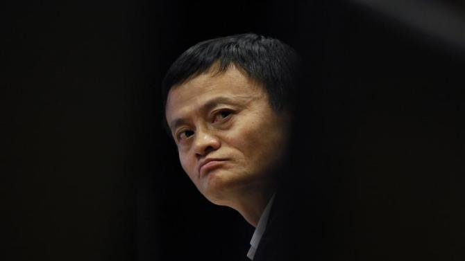 File of Jack Ma, chairman of China's largest e-commerce firm Alibaba Group attending a corporate event at the company's headquarters on the outskirts of Hangzhou, Zhejiang province