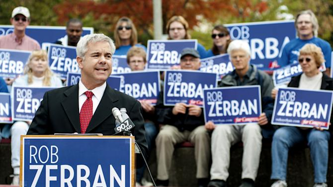 This photo taken Oct. 3, 2012 shows Wisconsin Congressional candidate Rob Zerban  speaking at campaign event inJanesvilles, Wis. As Zerban spent his morning on his hands and knees scrubbing a toilet in a homeless shelter. Half a country away, Paul Ryan stood under a spotlight in Virginia talking about why he should be the next vice president. So it goes in Zerban's longshot bid to seize the House seat Ryan has held for 14 years. While the Republican vice presidential hopeful has jetted around the country touting Mitt Romney, the Kenosha Democrat has been getting his hands dirty in southern Wisconsin's 1st Congressional District. (AP Photo/Mark Kauzlarich, The Janesville Gazette)