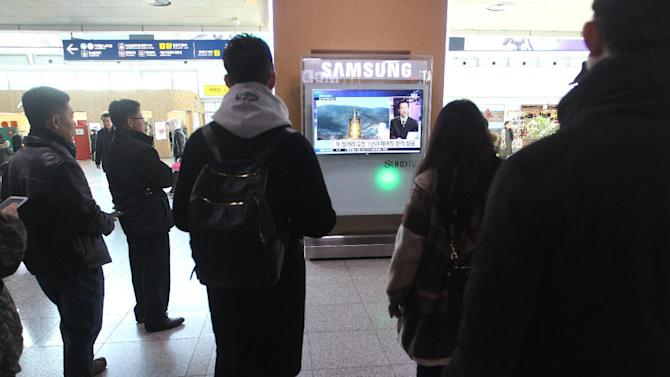 South Koreans watch a TV news program with a file footage about North Korea's rocket launch at Seoul Railway Station in Seoul, South Korea, Sunday, Feb. 7, 2016. North Korea on Sunday defied international warnings and launched a long-range rocket that the United Nations and others call a cover for a banned test of technology for a missile that could strike the U.S. mainland. (AP Photo/Ahn Young-joon)