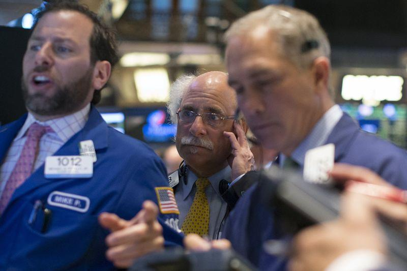 Wall St. mixed as lackluster earnings offset biotech M&A bid