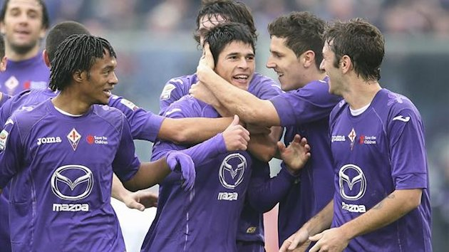 Facundo Roncaglia celebrates scoring from inside his own half for Fiorentina against Napoli (Reuters)