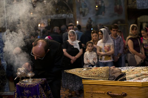 Armenians attend the funeral of Armenian Patriarch of Jerusalem Torkom Manougian in the Old City of Jerusalem, Monday, Oct. 22, 2012. The Armenian Patriarch of Jerusalem died at the age of 93. (AP Photo/Bernat Armangue)