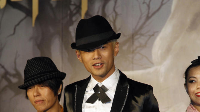 "Taiwan performer Jay Chou, center, poses for photographers during a press conference announcing his new CD ""Opus 12"" in Taipei, Taiwan, Thursday, Dec. 27, 2012. (AP Photo/Wally Santana)"