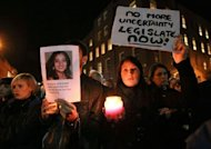<p>Protestors hold pictures of Indian Savita Halappanavar as they gather outside Leinster House during a demonstration in favour of abortion legislation in Dublin, Ireland. Ireland's tough abortion laws came under fire on Wednesday following the death of an Indian woman after doctors allegedly refused her a termination because it was against the laws of the Catholic country.</p>