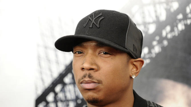 """FILE - In this March 2, 2010 file photo, rapper Ja Rule attends the premiere of """"Brooklyn's Finest"""" in New York. Ja Rule is set to be sentenced to two years in a New York Prison Wednesday, June 8, 2011 on a weapons possession charge. It resolves a nearly four-year-old case and makes Ja Rule the latest rapper to do time. (AP Photo/Peter Kramer, File)"""