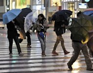 This file photo shows pedestrians crossing a street on a rainy in Tokyo, earlier this month. Japan&#39;s unemployment rate was unchanged at 4.5 percent in March, the internal affairs ministry said on Friday, in line with economists&#39; expectations