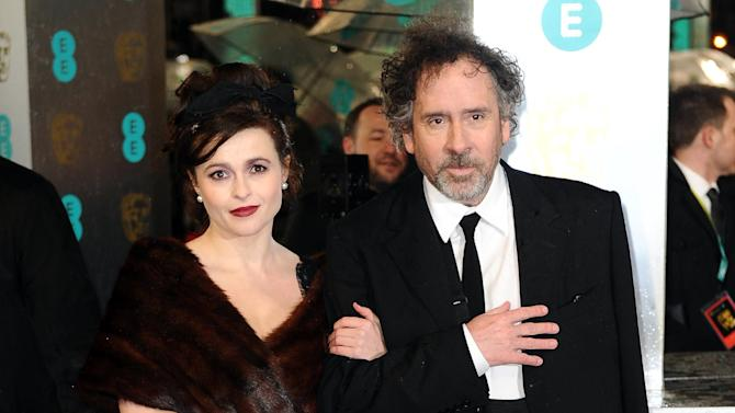 Helena Bonham-Carter, left, and her husband, American director Director Tim Burton arrive for the BAFTA Film Awards at the Royal Opera House on Sunday, Feb. 10, 2013, in London. (Photo by Jonathan Short/Invision/AP)