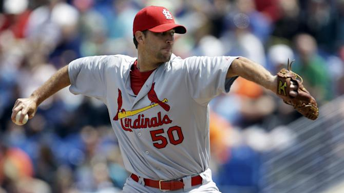 St. Louis Cardinals starting pitcher Adam Wainwright throws during the first inning of a spring training baseball game against the New York Mets, Tuesday, March 26, 2013, in Port St. Lucie, Fla. (AP Photo/Jeff Roberson)