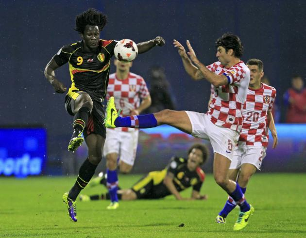 Belgium's Lukaku is challenged by Croatia's Corluka during their 2014 World Cup qualifying soccer match at Maksimir stadium in Zagreb