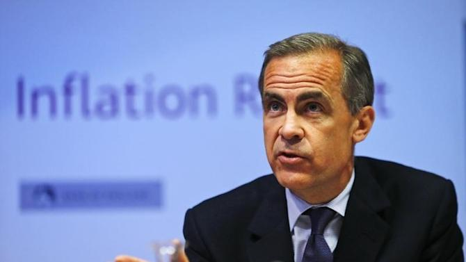 Bank of England governor Mark Carney listens during the bank's quarterly inflation report news conference at the Bank of England in London