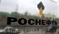 The Kremlin is reflected in the company plate of the state-controlled Russian oil giant Rosneft at the entrance of its headquarters in Moscow, in 2011. Rosneft said on Tuesday it had opened talks with the British energy group BP on acquiring a stake in the troubled but lucrative TNK-BP joint venture it co-owns with four tycoons