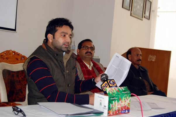 HPCA Vice-President Arun Thakur addresses a press conference in Dharamshala on Dec.19, 2013. The state cricket body is facing charges of cheating and fraud. (Photo: IANS)
