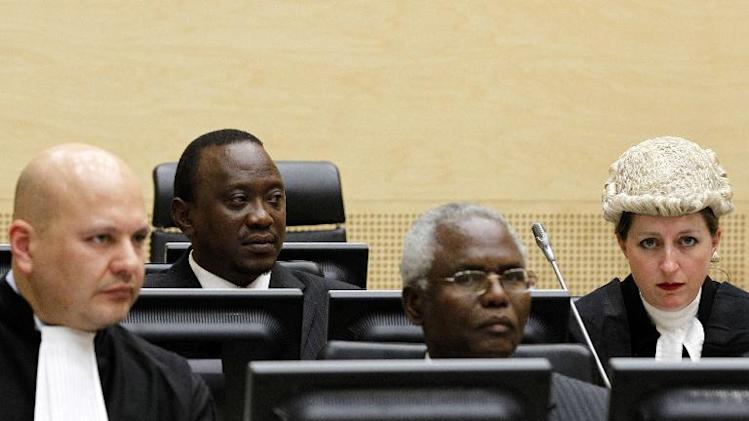 Kenyan Deputy Prime Minister and Finance Minister Uhuru Kenyatta (second-left), and Cabinet secretary Francis Muthaura (second-right) attend a hearing, at the International Criminal Court in The Hague, on August 8, 2011