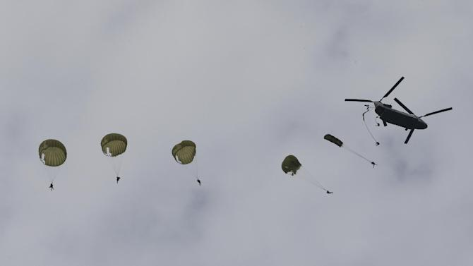 South Korean Special Forces soldiers parachute down from a helicopter during a ceremony to mark the 1950 Incheon landing operations Monday, Sept. 15, 2014, in Incheon, South Korea. In Sept. 1950, the United Nations Forces, led by U.S. Gen. Douglas MacArthur, landed on Incheon, just months after North Korea invaded the South. (AP Photo/Ahn Young-joon)