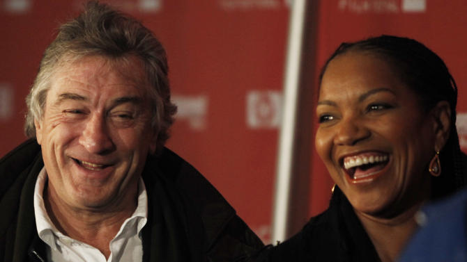 """FILE - Robert DeNiro, left, and Grace Hightower arrive at the premiere of """"Push"""" during the Sundance Film Festival in Park City, Utah in this Jan. 16, 2009 file photo. Stan Rosenfield, the 68-year-old actor's spokesman, said Friday Dec. 23, 2011  De Niro and his 56-year-old wife, Grace Hightower, welcomed a healthy 7-pound, 2-ounce baby girl named Helen Grace Hightower through a surrogate mother. She is the couple's second child.  (AP Photo/Matt Sayles, File)"""