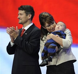 Sarah Palin holds her infant son, Trig, as she stands on stage with her husband, Todd, during the Republican National Convention in St. Paul, Minn., Sept. 3, 2008. (Photo: Susan Walsh/AP)