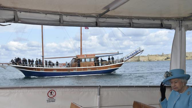 Britain's Queen Elizabeth tours the Grand Harbour in a traditional Maltese fishing boat during the State Visit and Commonwealth Heads of Government Meeting in Valletta