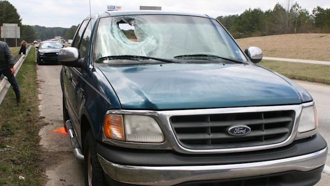 This undated photo provided by the Alabama Department of Public Safety shows the damage caused by a chunk of concrete that flew through a truck windshield, fatally injuring Jo Maureen Fisher of Goose Creek, S.C., on March 15, 2010. State troopers determined the concrete came from a pothole on Intersate 20 near Heflin, Ala., and her family blames the state for her death. (AP Photo/Ala. Department of Public Safety)