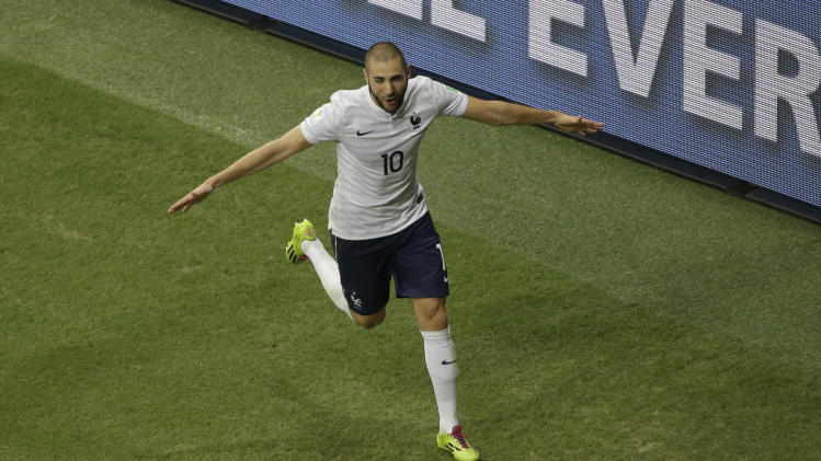 France's Karim Benzema celebrates before his goal was disallowed after Netherlands referee Bjorn Kulpers had blown his whistle for full time before the ball entered the gaol during the group E World Cup soccer match between Switzerland and France at the Arena Fonte Nova in Salvador, Brazil, Friday, June 20, 2014. (AP Photo/Sergei Grits)