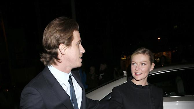 Kirsten Dunst and Garrett Hedlund arrive in a Cadillac XTS to the W Magazine's Best Performances and Golden Globe Awards Party Presented by Cadillac, on Friday, January, 11, 2013 in Los Angeles. (Photo by Todd Williamson/Invision for Cadillac/AP Images)