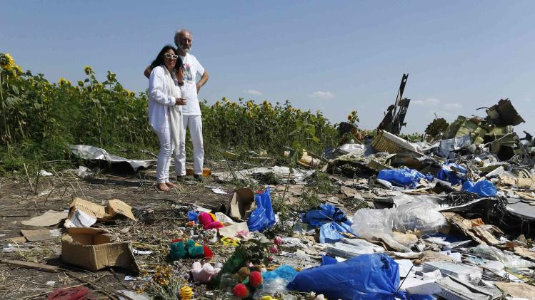 George and Angela Dyczynski visit the crash site of the downed Malaysia Airlines Flight MH17, during their visit to the crash site near the village of Hrabove