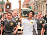 Leehom carries torch for Olympics