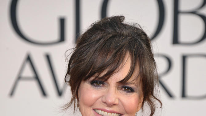 FILE - In this Jan. 13, 2013 file photo, Actress Sally Field arrives at the 70th Annual Golden Globe Awards at the Beverly Hilton Hotel, in Beverly Hills, Calif. Actors and actresses compete separately at awards shows, a tradition some in the industry consider vital for women but others question. (Photo by John Shearer/Invision/AP, File)