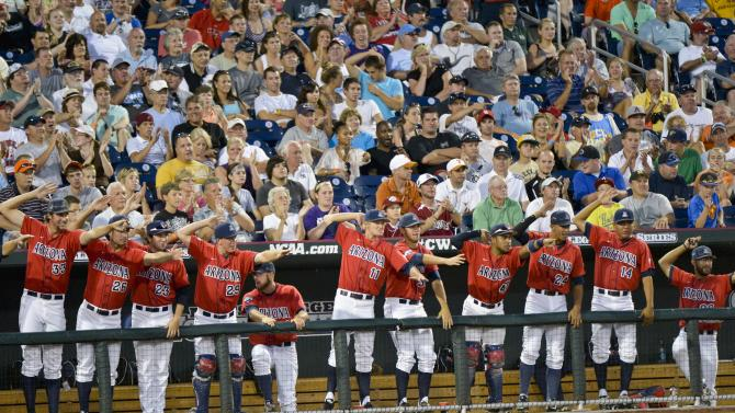 Players in the Arizona dugout celebrate in the fourth inning against UCLA in an NCAA College World Series baseball game in Omaha, Neb., Sunday, June 17, 2012. (AP Photo/Ted Kirk)