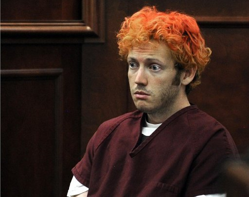 James Holmes appears in court at the Arapahoe County Justice Center July 23 in Centennial, Colorado. A psychiatrist who treated Holmes, accused of a mass shooting at a cinema showing the latest Batman film, alerted others weeks before his attack because she was worried about his behavior, a news report said.
