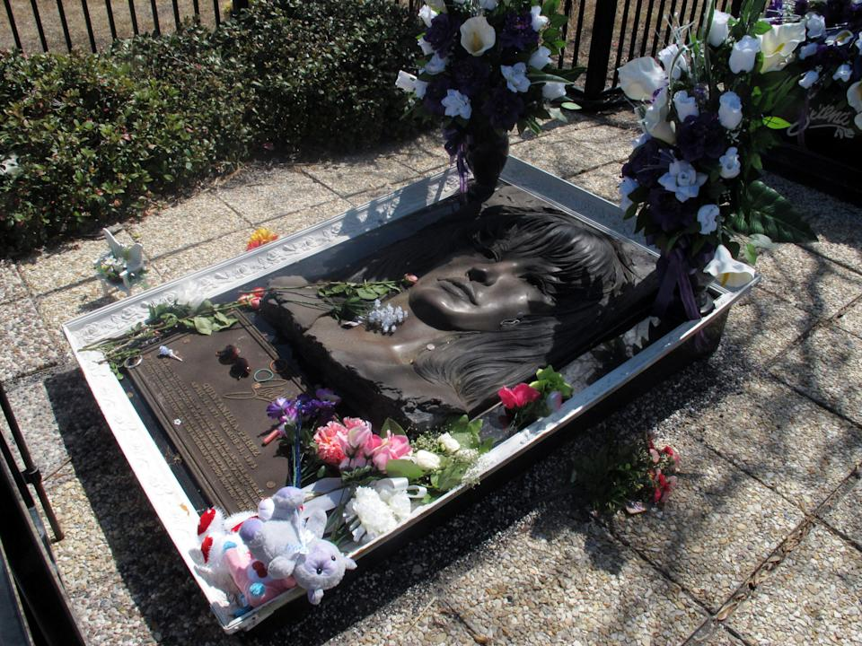 In this March 14, 2013 photo,  the resting place of the late Tejano singer Selena is shown at the Seaside Memorial Park in Corpus Christi, Texas. The coastal Texas city's deep roots in Mexican American history is often overlooked as visitors mainly come here for a quick beach getaway. (AP Photo/Russell Contreras)